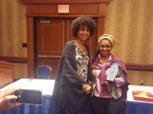 Ebony Coletu receiving prize from Selection Committee Chair, Akosua Adomako Ampofo